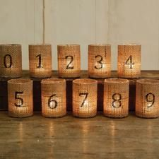 glass votives covered in burlap - this is for the picture only.  This site does offer them for sale