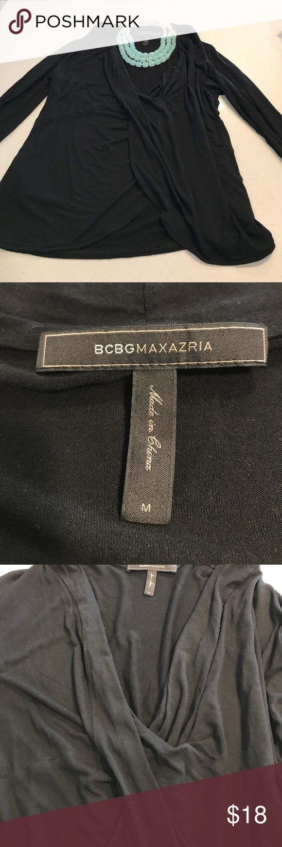 Black BCBGMaxazria top Black low v neck BCBGMaxazria top. Great with a statement necklace. Perfect for a dressy or casual night. Only worn once BCBGMaxAzria Tops