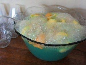 Ingredients  1/2 gallon rainbow sherbert 2 litres 7-Up 1 gallon Hawaiian fruit punch