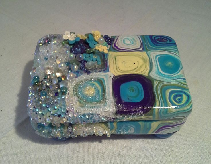 Altoid tin covered in polymer clay.