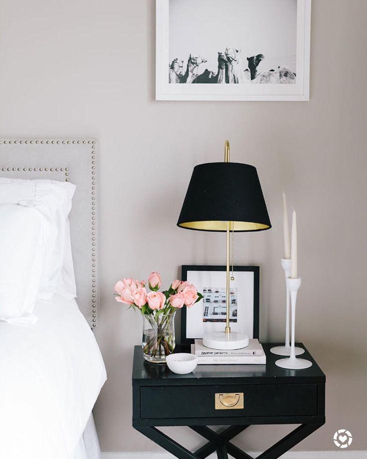 light grey walls & headboard, black side tables, b&w photos in white or black frames