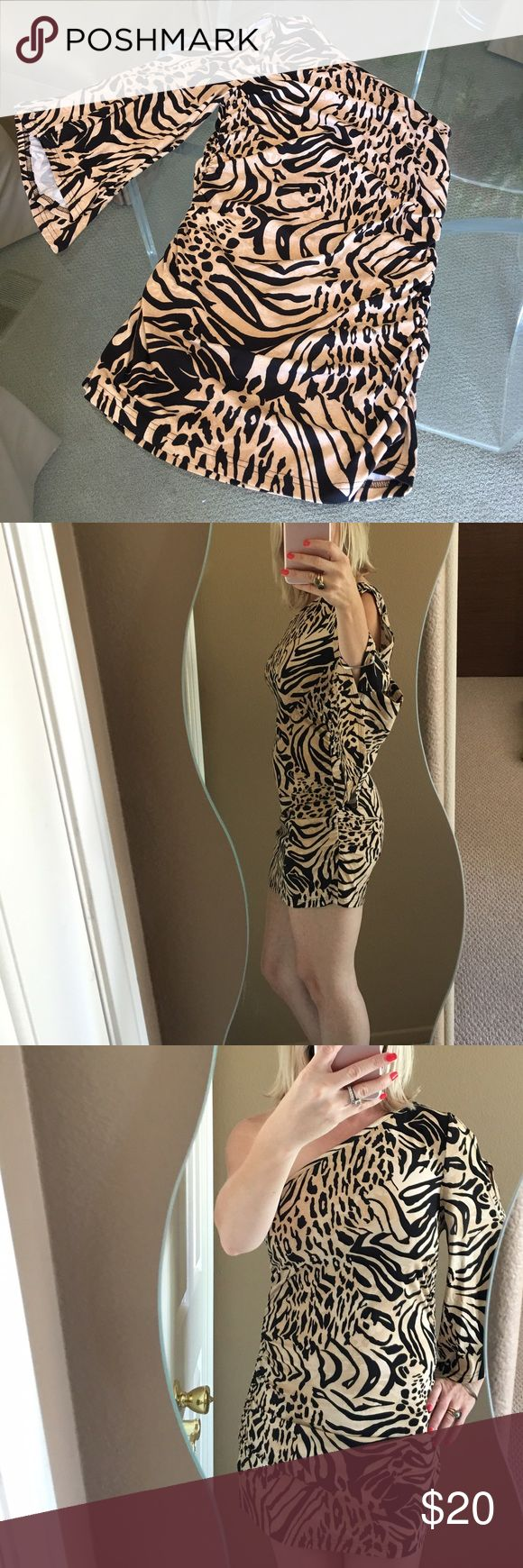 ❤️Venus Animal Print One Sleeved Mini Dress❤️ Sexy and cute cotton one sleeved animal print mini dress! Cut outs on bell sleeve expose upper arm and forearm. In excellent condition! 🌟 Venus Dresses Mini
