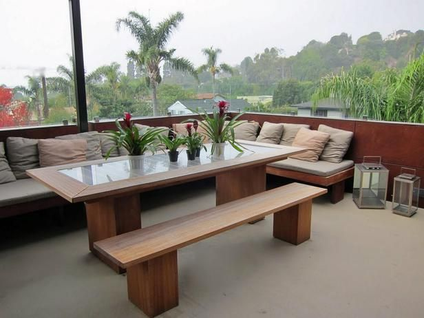 An outdoor dining deck with a custom mahogany table and bench.