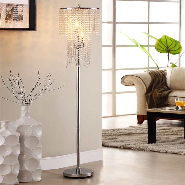 Casual lighting should be more than just functional, and this modern crystal floor lamp is evidence of that. The chrome lamp features glittering crystals, has a three-light fixture, and takes three 40-watt bulbs. Measures 63' high x 14' wide x 14' deep.