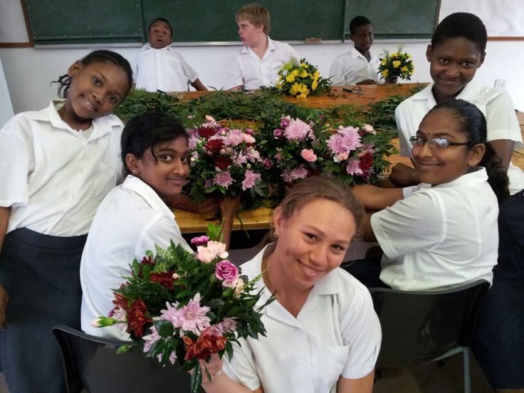 Smiles all round when these special pupils do Floral Art!