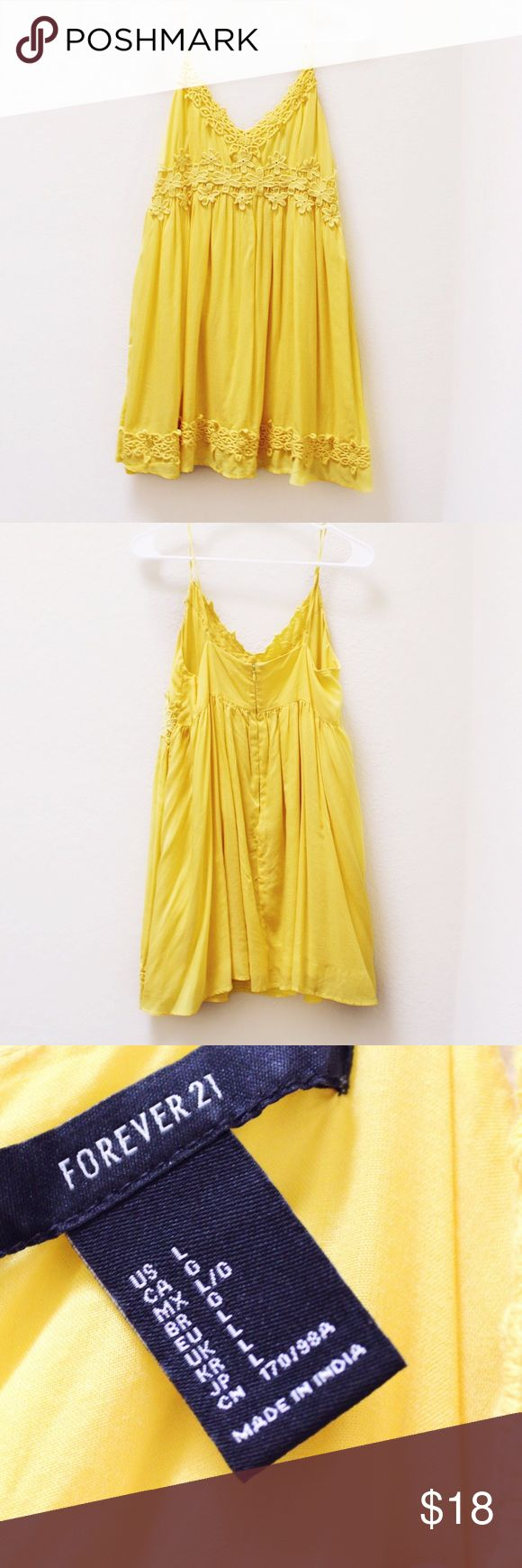 yellow mini dress Pretty little mini dress with lace details from forever 21. So retro looking! Looks like it is straight out of a glamorous Slim Aarons '60s poolside photograph ☀️ This is absolutely perfect for the spring and summer! Only worn twice and in great condition :) size large. Open to reasonable offers & I do bundles! Dresses Mini