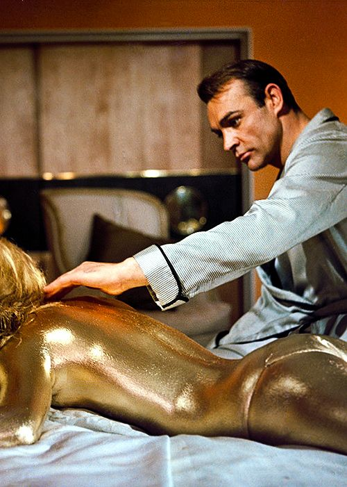JAMES BOND - Goldfinger 1964. Probably one of the most memorable (and sexy), death scenes in a movie ever! Jill Masterson (played by Shirley Eaton), is killed by being painted in gold.