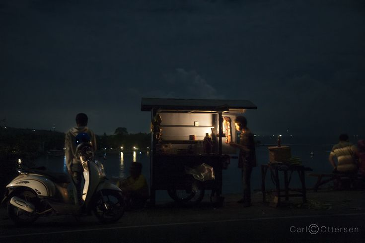 Stopping for a snack at a road side stall near Senggigi in Lombok at twilight.