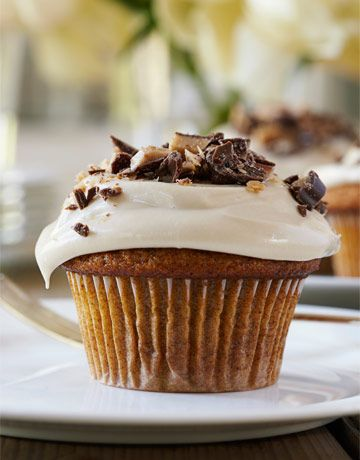 pumpkin cupcake with maple frosting and heath bar topping