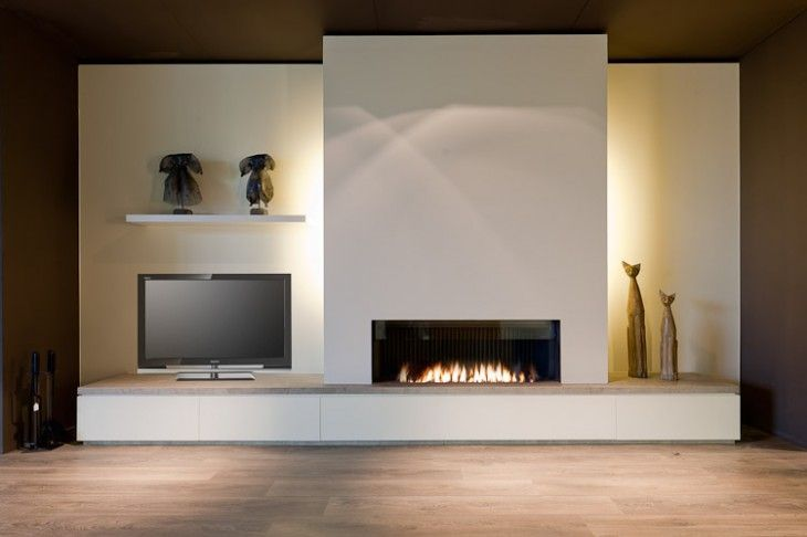 The back-lighting is nice around the fireplace.  The asymmetrical design is a little intriguing, but the TV looks very out of place.  Don't like the idea of having the rest of the room painted dark.