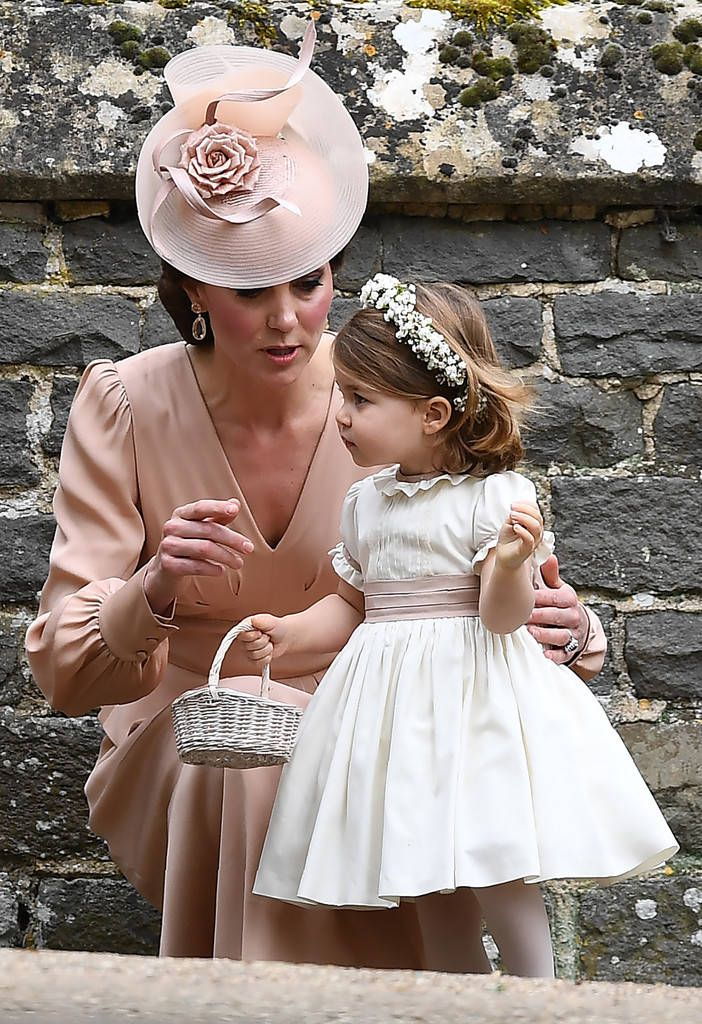 Kate Middleton and Princess Charlotte from Pippa Middleton and James Matthews' Wedding The Duchess of Cambridge as a chat with her bridesmaid daughter.