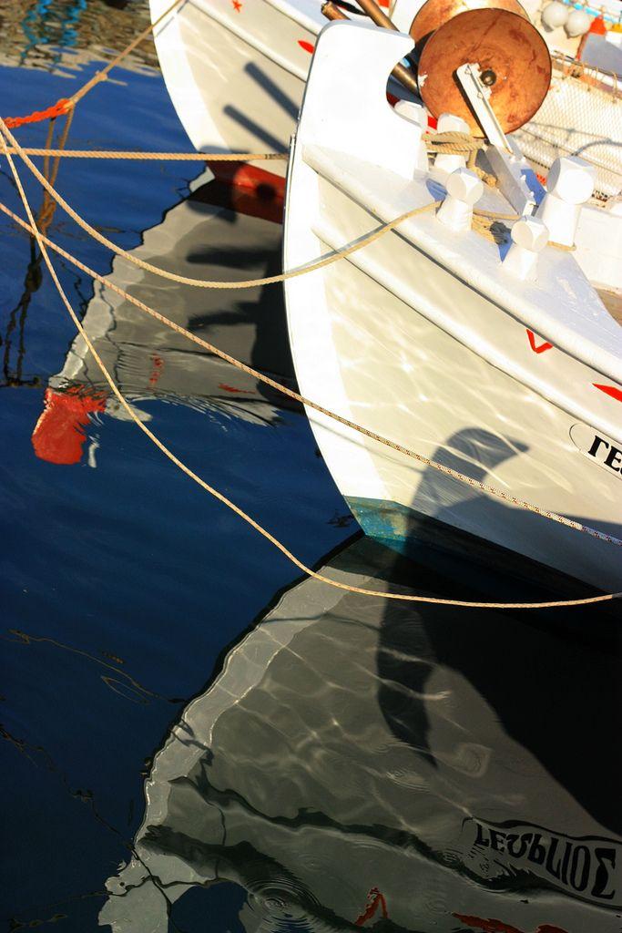 https://flic.kr/p/6W4zA6 | Tied boats | Fishing boats tied at dock with reflections. Karystos, Evia island, Greeee