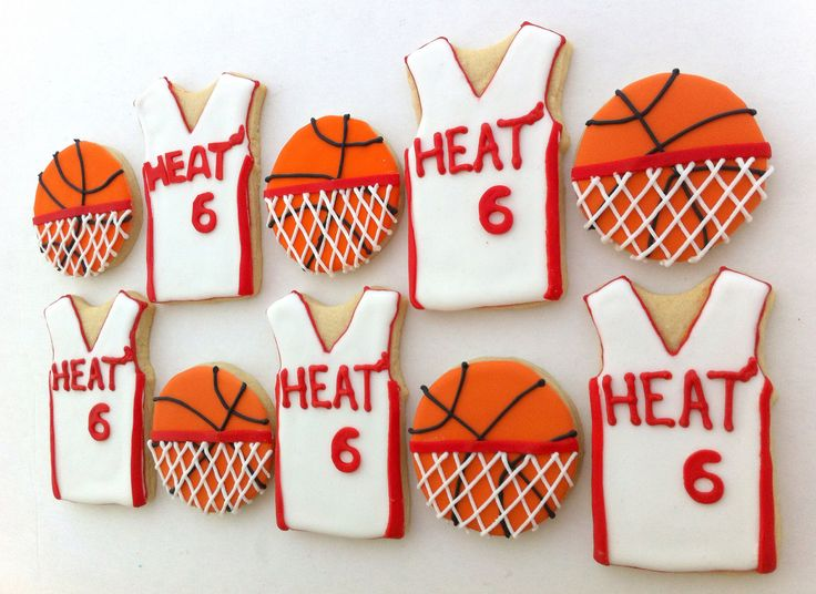 basketball jersey cookies- could reverse to white numbering and colored jersey with sugar sprinkles and white icing or sugar numbers