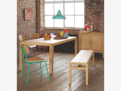 RADIUS Oak small dining table This understated and timeless Radius oak small dining table is beautifully crafted from lacquered solid oak and oak veneer and features rounded corners, joined in traditional methods.