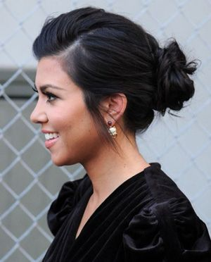 I like how the bun is not too high, but not to low, and the parted front has just a slight poof