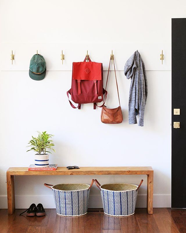 """Looking for a 30 minute project for the weekend? Help your entry stay organized with this DIY hook wall made from only a length of 8"""" primed pine and a few hooks spaced 8-12"""" apart. These brass beauties were just $6 each at @anthropologie and I love them! After you've painted the board, it's easiest to screw the hooks in first with the board laying on the ground. Then hang the hook board by screwing right through the front of the board into your wall studs. After that, just putty over the…"""