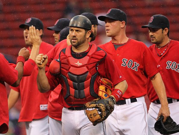 Jason Varitek Photos Photos - Catcher Jason Varitek #33 of the Boston Red Sox holds onto the ball after a collision at home plate with Brett Lawrie #13 of the Toronto Blue Jays at Fenway Park on September 14, 2011 in Boston, Massachusetts. The Blue Jays won the game 5-4. - Toronto Blue Jays v Boston Red Sox