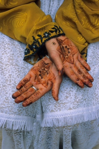 Berber girl with Henna body art on her hands, Ourika Valley, near Marrakech, Morocco