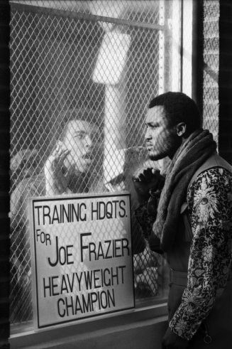 """Challenger Muhammad Ali taunts heavyweight champ Joe Frazier at Frazier's training camp in Pennsylvania ahead of their March 1971 """"Fight of the Century"""" title bout at Madison Square Garden. Frazier retained the championship belt in a unanimous 15-round decision. Originally published in the March 5, 1971, issue of LIFE. See more: http://ti.me/HyPia1 (John Shearer—Time & Life Pictures/Getty Images): Training, Joe Frazier, Ali Taunting, 1971, Muhammad Ali, Taunting Joe, Sports, Mohammadali, John Shearer"""
