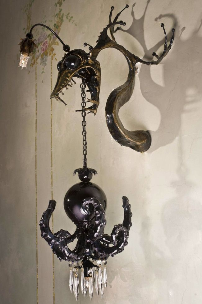 'Creating the chandelier from epoxy clay, spray paint and 'secret sauce to give it that classy glassy look,' Genius