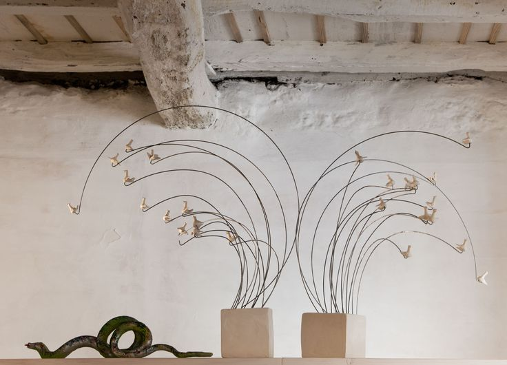 Two sculptures by Helena Cardoso: The Holy Spirit and the Divine Snake. Photo by Luís Ferreira Alves.
