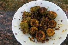 This recipe is a maharashtrian preparation of karela stuffed with peanut powder and spices