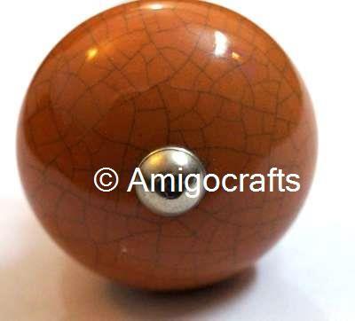 http://www.amigocrafts.com/ProductDetail.aspx?m=0&c=0&sc=22&q=78&tag=Honey%20%20Crackle%20Round%20Ceramic%20Knob