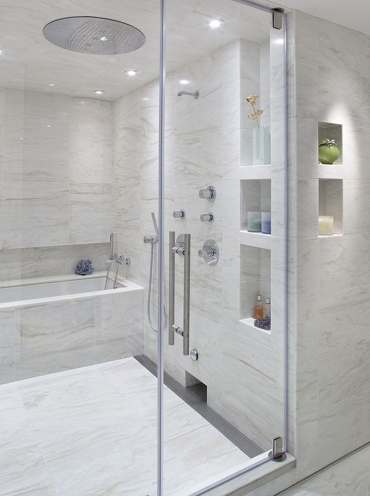 Love the built ins and the tub inside the shower. Plus the gray and white is tranquil and relaxing