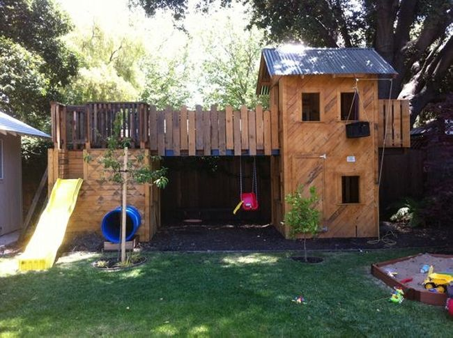 Making a big playhouse in the garden seems difficult but using pallet wood and a little effort it can be easily done. Join the playhouse with the sliding area by putting a bridge between them.  You can hang the ropes from the windows or you can put a tunnel inside.