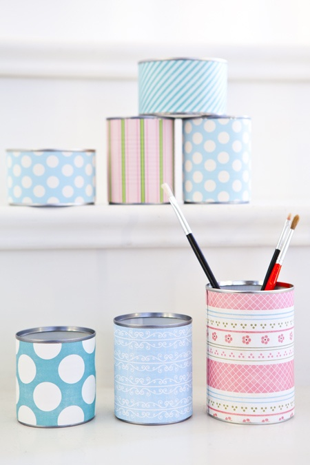 Cans with colourfull paper around
