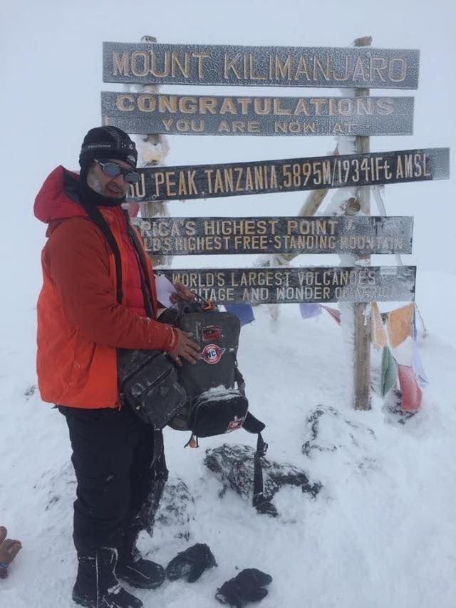 """Check out this BADASS, flashing his WCF sticker at the summit of Kilimanjaro. #goals  From George:  """"Mt. Kilimanjaro, the Roof of Africa and one of the Seven Summits. One of the hardest things I've ever done. A little more than a 7hr slog to the peak from base camp, covering over 4,000 ft, with treacherous footing and thigh-deep snow in places. """"By endurance we conquer!"""" 👊🏼 """"  AWESOME JOB GEORGE! All that hard work has paid off. Congrats! 🎉🗻  #mountainPRs #ontothenextone ✅ #badassmembers"""