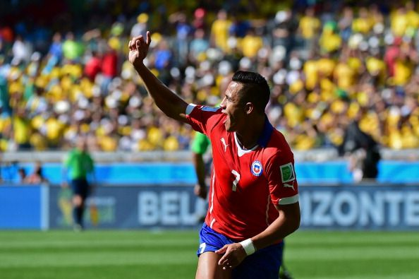 Chile's forward Alexis Sanchez celebrates after scoring a goal during the Round of 16 football match between Brazil and Chile at The Mineirao Stadium in Belo Horizonte during the 2014 FIFA World Cup on June 28, 2014.  A