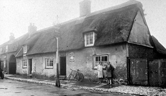 "The old ""Hatchet & Bill"" public house, Main Street, Yaxley. Demolished in 1920's,"