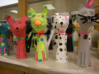 4th graders learned the difference between shape (2-D) and form (3-D) while creating these papier mache pets. Students could choose betwe...