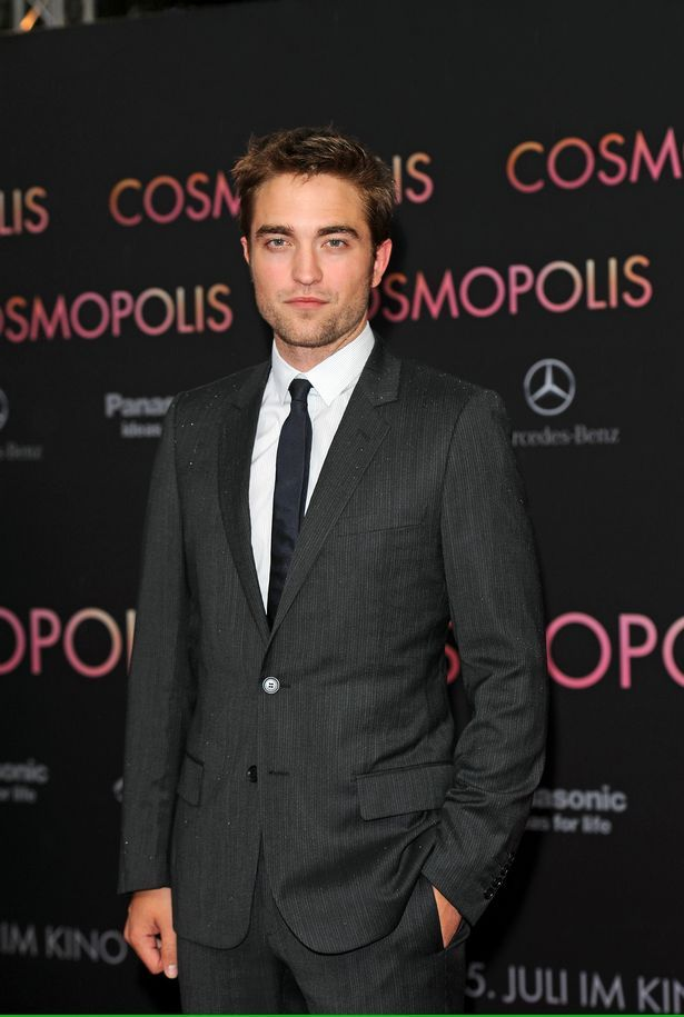 He's hot, particularly in a suit, is our Robert Pattinson.  Robert Pattinson voted world's sexiest man again... 4th year in a row... are you reading this Kristen?