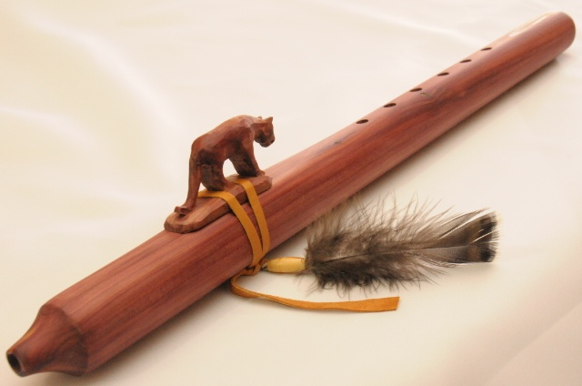 beautiful Native American flute with a mountain lion hand carved on it.<3