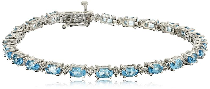 """Sterling Silver Oval Swiss Blue Topaz and Diamond Accent Tennis Bracelet, 7.25"""". Sterling Silver bracelet featuring 23 oval cut Swiss Blue Topaz gemstones and diamond accent. Gemstones may have been treated to improve their appearance or durability and may require special care. The natural properties and composition of mined gemstones define the unique beauty of each piece. The image may show slight differences to the actual stone in color and texture. Blue Topaz is December's birthstone...."""