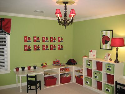 look how beautiful this mom organized her lil girls playroom!!! thats the green im lookin to paint the top half of emmys room =)