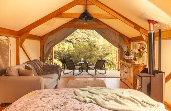 Phoenix Valley, Tauranga » Canopy Camping: secluded and private luxury tent complete with a king-sized bed, log burner and not to mention your very own private deck, glamping at Phoenix Valley really is the creme de la creme!