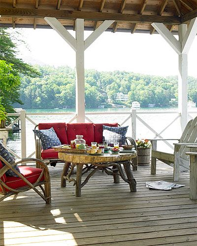 Boathouse deck. Gorgeous garden, gorgeous porch. I could live here - I think! Adirondack chairs and midcentury bentwood seating, as well as a coffee table crafted by a local artisan, furnish this summer ...