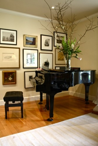 Nice use of various types of framed art, arranged as a group on a good sized wall space.