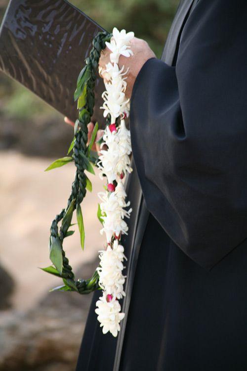 This Hawaiian wedding ceremony begins with a beautiful Hawaiian wedding chant, followed by the Hawaiian lei exchange and ring blessing with Hawaiian bowl