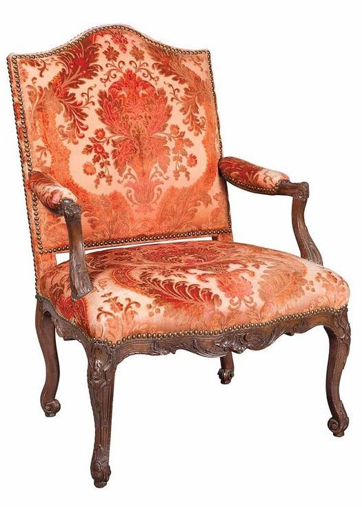 Louis XV Walnut Fauteuil a la Reine Mid 18th century The arched rectangular padded back and seat raised on cartouche carved cabriole legs ending scrolling toes.