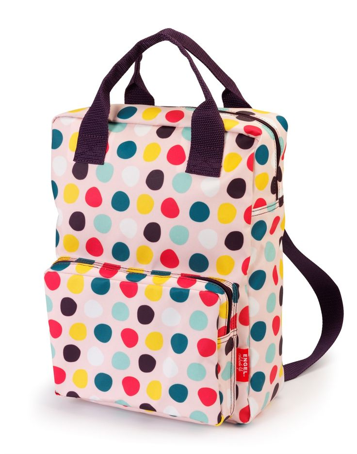 School bag - Dots  You can't tell, but isn't it great to know that the outside of this lovely little backpack is made of recycled squash bottles? Which means it's environmentally friendly too. The bag has a polyester lining, and both the main compartment and outer pocket close wi