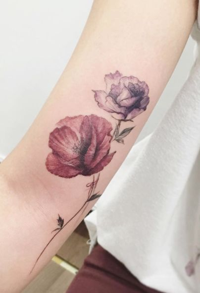 Poppy and rose tattoo by Tattooist Flower