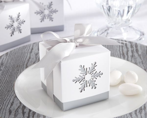 Whether you are planning a winter wedding or holiday party, these Silver Winter Snowflake Favor Boxes are sure to dazzle your guests.  Stunning favor box with white, slip-on top, intricate, precision-cut snowflake design and silver-gray satin ribbon and bow.