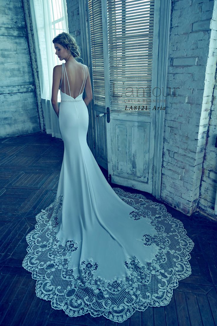 LA8121 Aria Sleek and sexy high neck crepe gown with intricate hemlace.  The design is finished off with a low back and beaded belt detail.  #callablanche #callabride #crepe #highhemlace #beadedbelt #weddingdress #wedding #bride #bridalgown #bridal #lowback #fitandflare #latticework