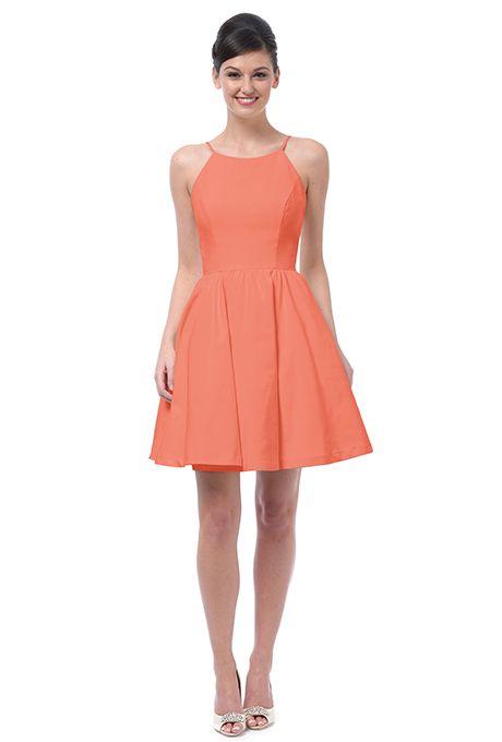 A short, coral bridesmaid dress by Weddington Way   Brides.com
