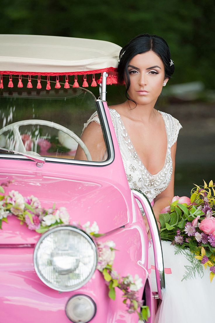 a garland of flowers for a vintage car and wildflower bouquet, part of a recent photo shoot we were lucky enough to be part of Vintage Italian Summer Wedding
