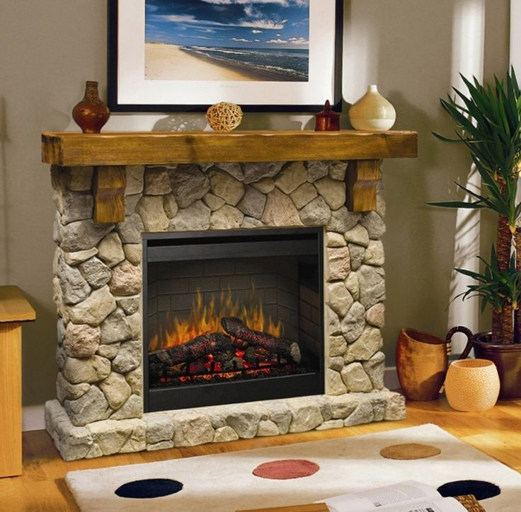 Beige Stone Fireplace With Brown Wooden Mantel Shelf And Black Metal  Firebox Connected By Beige Rug